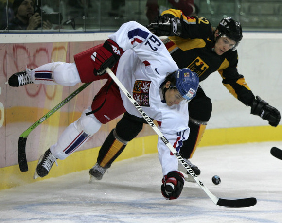 Czech Repubic wing PATRIK ELIAS (62) collides with Germany defenseman ALEXANDER SULZER (52) behind the net at the 2006 Winter Olympic Games in Turin, Italy. The Czech Republic won this Olympic opener 4-1 but lost Elias for the remainder of the tournament. Elias, a two-time Olympian, has been selected for six major internationals (20 ga, 12 go 6 as, 18 pts) by the Czech Republic.