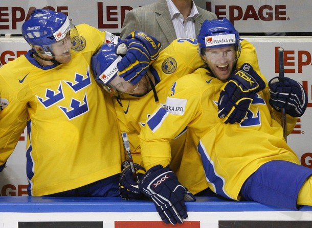 ROBERT NILSSON (center) celebrates a victory over the Czech Republic at the 2008 IIHF World Championships with PATRIC HORNQVIST (left) and NILS EKMAN.