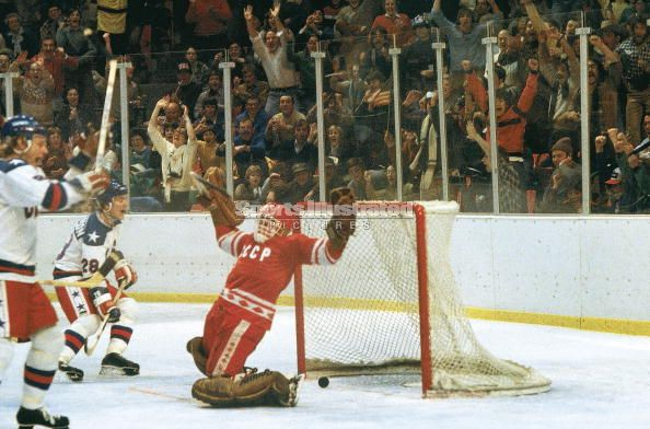United States right wing JOHN HARRINGTON (28) reacts to third period wrist shot of MIKE ERUZIONE (not pictured), which has beaten USSR goalie VLADIMIR MYSHKIN for what will be the winning goal of the Americans' famous 4-3 upset of the Soviet Union at the 1980 Winter Olympic Games in Lake Placid. Four years later at Sarajevo, Harrington was rumored to be involved in the controversy concerning player eligibility.