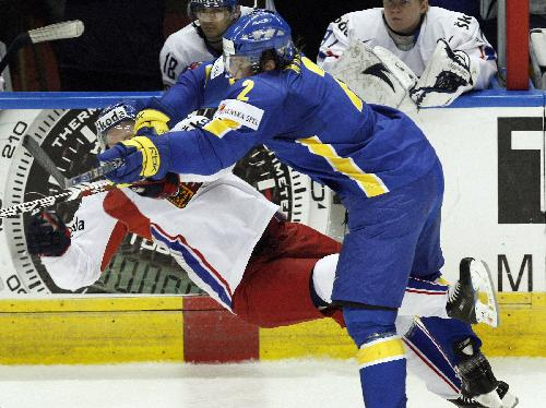 Sweden national team coach BENGT-AKE GUSTAFSSON did not include defenseman DOUGLAS MURRAY (2) on his Olympic roster for the San Jose Shark's offensive abilities on the blue line. Here, at the 2008 IIHF World Championships in Canada, Murray cashes a Czech Republic forward at the bench.