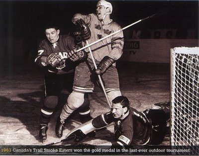 "SVEN ""Tumba"" JOHNASSON is still the all-time leading scorer for Sweden at the Winter Games. The four-time Olympian notched 28 goals in 30 games and earned two medals, one silver and one bronze. Here, Tumba tangles with the Canadian defense at the 1961 IIHF World Championships in Switzerland as goaltender SETH MARTIN scrambles for the puck."