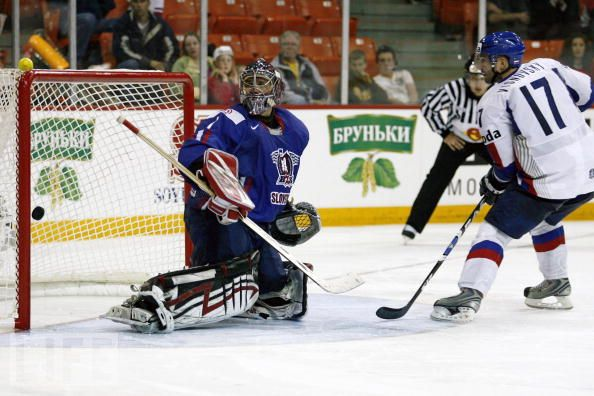 Slovakia defenseman LUBOMIR VISNOVSKY flips the puck past Slovenia goaltender ANDREJ HOCEVAR during the shootout round of the qualification round match between the two nations at the 2008 IIHF World Championships in Canada. Slovakia topped Slovenia 4-3 but failed to advance to the quarterfinal round.