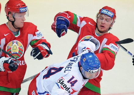 Belarusian defensemen VLADIMIR DENISOV (right) and ALEXANDER RYADINSKY (left) double-team Czech Republic forward TOMAS PLEKANEC at the 2009 IIHF World Championships. Denisov, 25, has two years' experience at the American Hockey League level playing 66 games (2 go 6 as, 8 pts, 111 pim) for the Lake Erie Monsters in 2007-08 and 62 games (5 go 15 as, 20 pts, 117 pim) for the Hartford Wolf Pack last season.