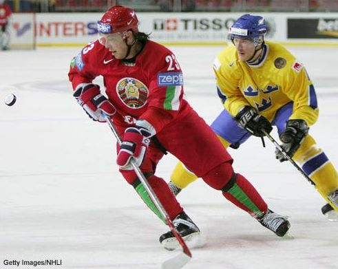 Belarus center ANDREI KOSTITSYN (23) keeps his eye on the airborne puck at the 2008 IIHF World Championships in Canada. Sweden defeated Belarus 6-5 in this match. The two nations are drawn together in Group C at the 2010 Winter Olympic Games this February in Vancouver.
