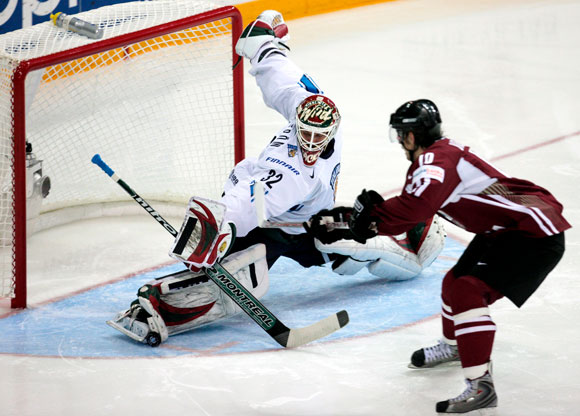 LAURIS DARZINS (10) shoots past Finnish goalie NIKLAS BACKSTROM to give Latvia an early 1-0 lead in the qualification round at the 2008 IIHF World Championships in Canada. Finland eventually rallied for a 2-1 victory over Lativa. Darzins, 24, is a legitimte young goal scorer on the wing for Latvia, with nine markers in 25 matches at major international events.