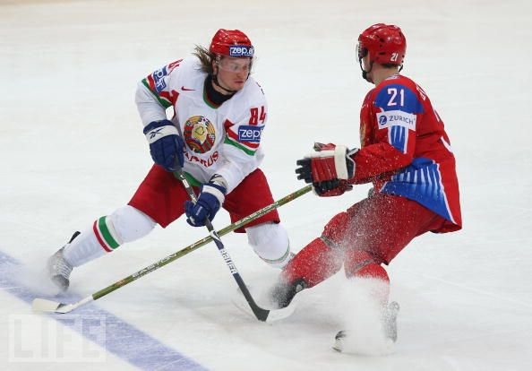 Belarus center MIKHAIIL GRABOVSKY (84) is confronted by Russia's KONSTANTIN GOROVIKOV during the quarterfinal match at the 2009 IIHF World Championships in Switzerland. Russia slipped past Belarus 4-3 on their way to a second consecutive IIHF WC title. The 25-year-old Grabovsky, meanwhile, is well on his way to becoming the all-time scoring leader for the Belarusians.