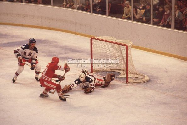 United States netminder JIM CRAIG thwarts the Soviet Union's Lativan legend, HELMUT BALDERIS (19), as defenseman BILL BAKER (6) observes in the famous 4-3 upset of the USSR by the Americans at the 1980 Winter Olympic Games. At Lake Placid in Craig, a 1977 fourth round NHL draft pick (# 72 overall) of the Atlanta Flames, the Soviets ran into one genuine red hot goaltender.