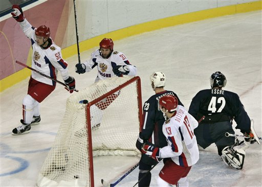 Russian defenseman ANDREI MARKOV (52), left, signals his second period goal against United States netminder ROBERT ESCHE as MAXIM SUSHINSKY (33) and PAVEL DATSYUK (13) look on at the 2006 Winter Olympic Games in Turin, Italy. Russia defeated the United States 5-4 in the round-robin. Markov, meanwhile, has three goals and four points his first three games back for the Montreal Canadiens after a lengthy spell on the injury list.