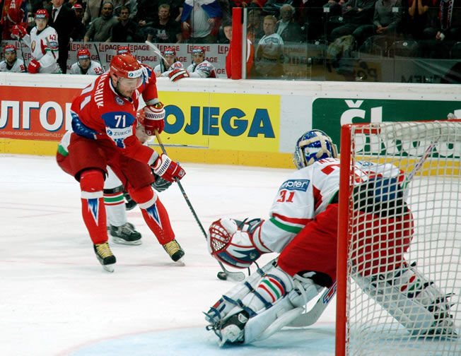 Belarus goaltender ANDREI MEZIN prepares to face Russia's ILYA KOVALCHUK (71) as the players on Belarus' bench anxiously observe in the quarterfinal round at the 2009 IIHF World Championships in Switzerland. The experienced Mezin was selected to the All-Star squad at the 2006 IIHF WC and was chosen both an All-Star as well as the best goalie last spring's major international event. Mezin will be key to the Belarusians' fortunes in Vancouver this February.