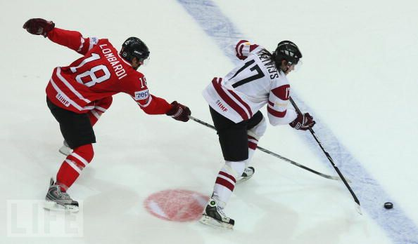 ALEKSANDRS NIZIVIJS (17) is Latvia's all-time leading scorer at major international ice hockey events. Here, the 33-year-old Dynamo Riga right wing is pursued by Canada's MATTHEW LOMBARDI at the 2009 IIHF World Championships in Switzerland.