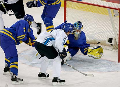 Finland winger VILLE PELTONEN (16) flips the puck past Sweden goalie HENRIK LUNDQVIST at the fifteen mark of the second period to square the Gold Medal Match of the 2006 Winter Olympic Games at two goals. Sweden ultimately triumped 3-2 on Niklas Lidstrom's goal ten seconds into the final frame.