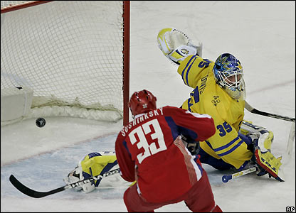 MAXIM SUSHINSKY shoots past goaltender HENRIK LUNDQVIST for Russia's third goal in the 5-0 round-robin victory over eventual champion Sweden at the 2006 Winter Olympic Games in Turin, Italy. Sushinsky, who played 30 games (7 go 4 as) for the NHL's Minnesota Wild in the 2000-01 season before returning to Avangard Omsk, has represented Russia seven times (51 ga, 17 go 18 as, 35 pts) at major internatioal events.