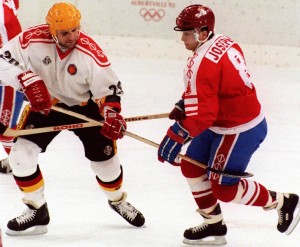 Germany's PETER DRAISAITL (20) tangles with FABIAN JOSEPH (8) of Canada at the 1992 Winter Olympic Games in Albertville, France. Canada narrowly defeated Germany after overtime and a penalty-shot shootout.