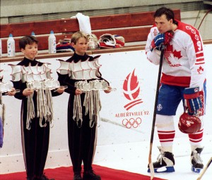 Canada's JOE JUNEAU (9) does not appear to be too excited about the set of silver medals, one of which the Boston Bruins' draft pick is due at the 1992 Winter Olympic Games in Albertville, France.