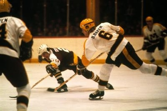 BILL BAKER fires a shot for the University of Minnesota against their in-state rivals, the University of Minnesota-Duluth, in WCHA play. Baker was an All-American defenseman for the Golden Gophers his senior season of 1978-79 and represented the United States at the 1979 IIHF World Championships in Moscow.