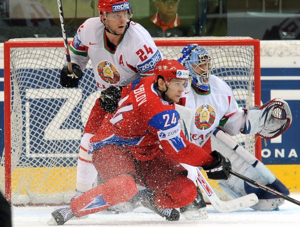Belarusian defender RUSLAN SALEI (24) struggles with his opposite number in red, Russian forward ALEXANDER FROLOV, in the quarterfinals at the 2009 IIHF World Championships in Switzerland. Both players are Western Division rivals in the National Hockey League. Frolov was not selected by Russia for the Vancvouver Games; time will tell if Salei's back obliges for the 2010 Winter Olympics.