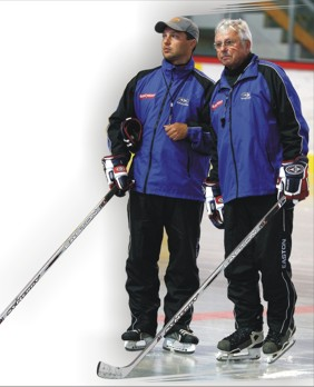 LUDEK BUKAC (right) with his son, LUDEK JR. (left); the father and son have operated a highly successful youth hockey school in the Czech Republic since 1991.