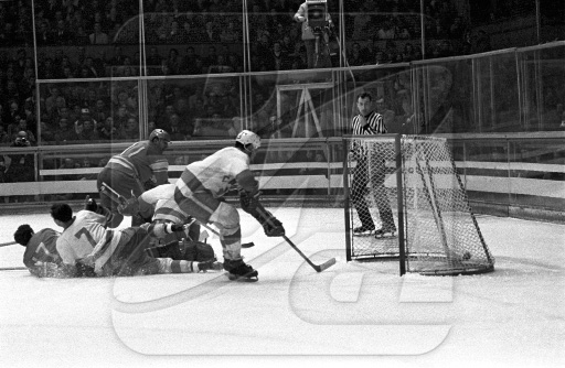 ANATOLI FIRSOV (11) scores a spectacular goal, his second of the game, as the USSR shutout Canada 5-0 in the final match of the 1968 Winter Olympic Games at Grenoble, France.