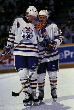 REIJO RUOTSALAINEN (29), right, confers with fellow Finn JARI KURRI (17) for the powerhouse Edmonton Oilers of the National Hockey League. Ruotsalainen joined the Oilers in the spring of 1987 after spending the winter with SC Bern in Switzerland. The smooth-skating rearguard rejoined the Oilers in the spring of 1990 after a trade from the New Jersey Devils just in time to capture a second Stanley Cup with Edmonton.