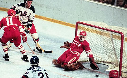 The puck slides anxiously through the crease of Soviet goalie VLADIMIR MYSHKIN (1) during the third period of the United States' 4-3 victory over the USSR at the 1980 Winter Olympic Games in Lake Placid.