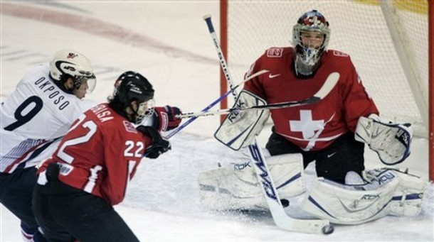 United States forward KYLE OKPOSO (9) and Switzerland defenseman LUCA SBISA (22) cross sticks as NHL first round draft picks collide at the 2008 IIHF World Junior Championships in Liberec, Czech Republic.