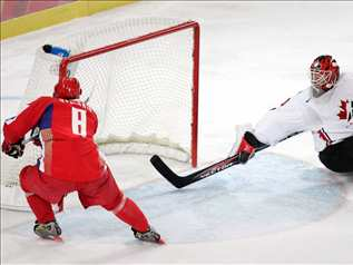 ALEXANDER OVECHKIN (8) opens the scoring for Russia in the third period of the quarterfinals against Canada at the 2006 Winter Olympics in Italy. Russia blanked Canada 2-0.