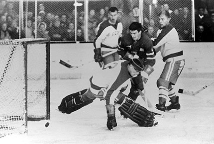 United States forward BILL CHRISTIAN shoots the puck past Soviet Union goalkeeper NIKOLAI PUSHKOV with five minutes remaining in the third period for the winning goal in the American's 3-2 upset victory over the USSR at the 1960 Winter Olympic Games at Squaw Valley, California.    