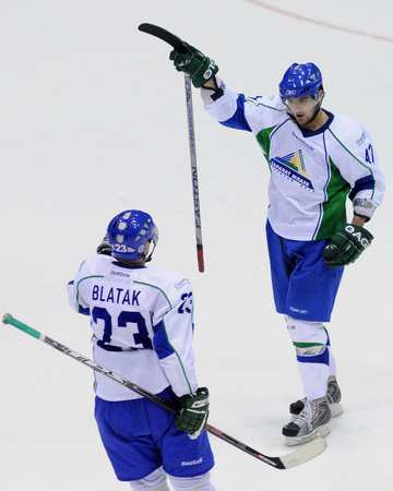 Russian winger ALEXANDER RADULOV (47) signals one of his 19 KHL goals this season as Czech Republic defender MIROSLAV BLATAK (23) acknowledges for Salavat Yulayev Ufa. The club teammates are slated to meet as national team foes in the round-robin at the 2010 Winter Olympic Games in Vancouver.