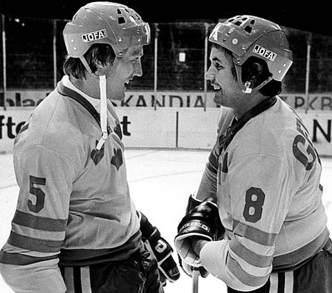 Toronto Maple Leafs' NHL All-Star defenseman BORJE SALMING (5) discusses matters with his older brother, defenseman STIG SALMING (8) of IF Brynas Galve, in preparation for the 1976 Canada Cup.