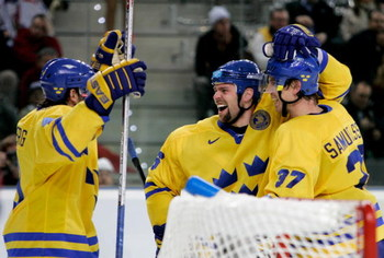 TOMAS HOLMSTROM (96), center, with Swedish teammates PETER FORSBERG (21), left, and MIKAEL SAMUELSSON (37) at the 2006 Winter Olympic Games in Turin, Italy. Holmstrom has hurt his foot for the NHL's Detroit Red Wings and could be out up to a month. Forsberg, meanwhile, is still on the shelf in Sweden's Elitserien.