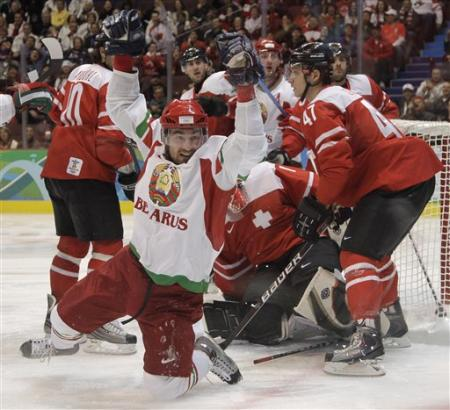Kalyuzhny has scored and in the process collects his third goal of the 2010 Vancouver Games and 13th career goal for Belarus at major tournaments. Kalyuzhny, totals from Vancouver included, is the all-time leader in both assists (21) and points (34) for the Belarussian national team. (Matt Slocum/AP)