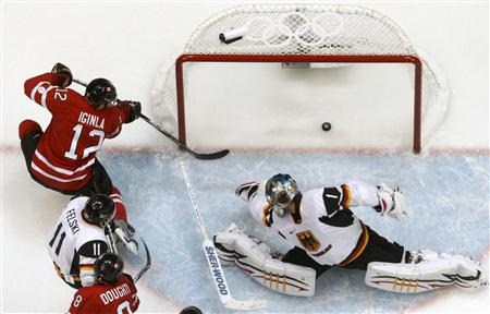Canada's JAROME IGINLA (12) scores his second and Canada's fourth goal against Germany goaltender THOMAS GREISS almost nine minutes into the second period as German forward SVEN FELSKI (11) and Canadian defenseman DREW DOUGHTY (8) fight in front at the 2010 Winter Olympics. Host nation Canada hammered Germany on home ice 8-2 and advances to face historical rival Russia in the quarterfinal round. Iginla scored a hat trick in Canada's 8-0 opening-game victory over Norway in Vancouver. (Hans Deryk/Reuters)