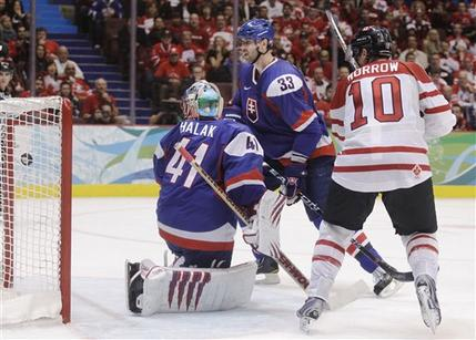 The Slovakian goaltender Halak (41) turns his head in time to see the puck cross the plane of the goal as Chara (33) can only watch. Canada's Morrow (10) is already in the midst of raising his stick for celebrations. (Matt Slocum/AP)