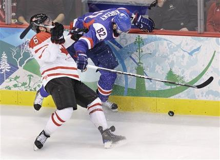 The Slovak forward Kopecky catches a stick in the mid-section from Canada defenseman SHEA WEBER (6) in pursuit of the puck at the 2010 Winter Olympic semifinal match in Vancouver. (Chris O'Meara/AP)