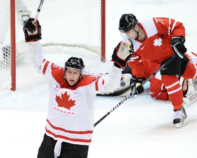 San Jose Shark star DANY HEATLEY (15) signals his opening goal for Canada against Switzerland at the 2010 Winter Olympic Games in Vancouver. (Matthew Manor/HHOF-IIHF Images) 