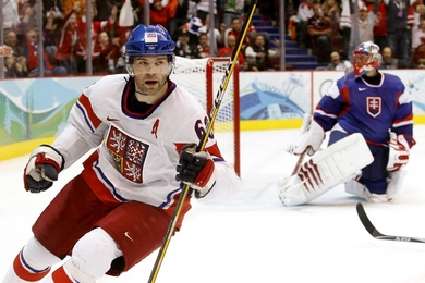 Czech Republic star JAROMIR JAGR (68) peels away after depositing the puck past Slovakia goaltender JAROSLAV HALAK. Jagr's second period strike proved to be the game-winning-goal in the Czech Republic's 3-1 conquest at the 2010 Vancouver Games. (Jukka Rautio/HHOF-IIHF Images)