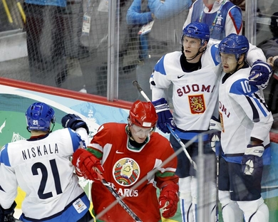 NIKLAS HAGMAN (10), the son of the first Finnish player to ever skate in the National Hockey League, celebrates the first of his two goals with MIKKO KOIVU (9) and JANNE NISKALA (21) during Finland's 5-1 victory over Belarus at the 2010 Vancouver Games. (Jukka Rautio/HHOF-IIHF Images)