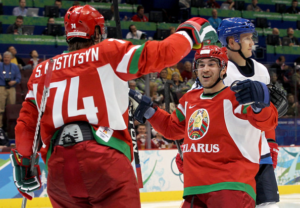 The all-time leading scorer at major international events for Belarus, ALEXEI KALYUZHNY of Dynamo Moscow, congratulates SERGEI KOSTITSYN (74) of the Montreal Canadiens on his first career goal at a major international tournament for his country at the Winter Olympics in Vancouver. (Bruce Bennett/Getty Images)
