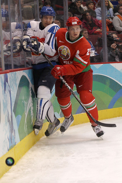Finnish forward NIKLAS HAGMAN (10) is crunched against the boards by Belarussian defenseman SERGEI KOLOSOV (25), a Detroit Red Wings farmhand with the Grand Rapids Griffins of the American Hockey League, at the Vancouver Games. (Bruce Bennett/Getty Images)