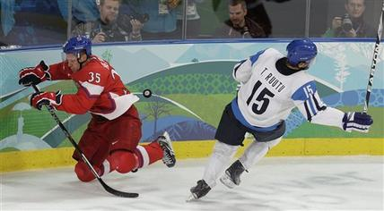 A hard hit from Czech defender JAN HEJDA (35) along the boards dispossesses Finland forward TUOMO RUUTU (15) of both the puck and his balance at the Vancouver Games. (Chris O'Meara/AP)