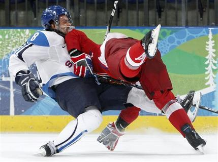 Finnish winger TEEMU SELANNE (8) wrecks with Czech defenseman MAREK ZIDLICKY (3) in the quarterfinals of the 2010 Winter Olympics in Vancouver. (Gene J. Puskar/AP)