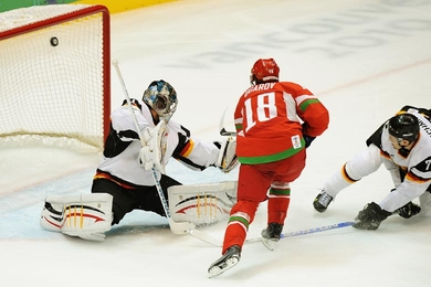 Belarus forward ALEXEI UGAROV (18) beats German goaltender THOMAS GREISS (1) on the backhand after a fine defensive play and solo rush. Unable to do anything about Ugarov is German defenseman CHRISTOPHER SCHMIDT (7). (Matthew Manor/HHOF-IIHF Images)