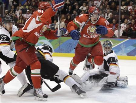ALEXEI UGAROV trips triumphantly after tying the score for Belarus in the opening period against Germany. (AP photo)