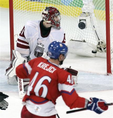 Boston Bruins forward DAVID KREJCI (46) scores 5:10 into overtime to lift the Czech Republic past a plucky Latvia 3-2 in the qualification round at the 2010 Winter Olympics. The Czechs move on to face Finland in the quarterfinals at the 2010 Vancouver Games. (Chris O'Meara/AP photo)