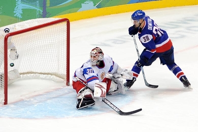 Slovakia's PAVOL DEMITRA (38) flips the puck past Russia goaltender ILYA BRYZGALOV (30) for the game-winning-goal in an epic penalty-shot shootout which went seven rounds. Slovakia, who defeated Russia 5-3 in the round-robin four years ago at the Turin Games, scored yet another victory over their Eastern European rivals this year in Vancouver. (Matthew Manor/HHOF-IIHF Images)
