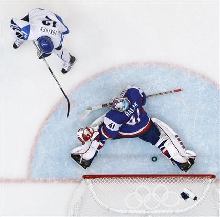 Finnish forward OLLI JOKINEN backhands the puck past Slovakia goaltender JAROSLAV HALAK (41) in the third period for the winning goal in Finland's 5-3 triumph in the Bronze Medal Match at the 2010 Winter Olympic Games from Vancouver, Canada. (Matt Slocum/AP) 