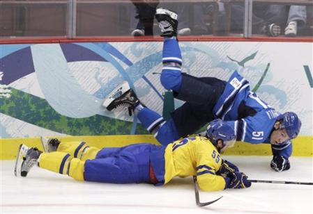 Two Detroit Red Wings --- Finnish forward VALTTERI FILPPULA (51) and Swedish defenseman NIKLAS KRONWALL (55) --- collide at Vancouver in the battle for Scandinavian supremacy renewed at the 2010 Winter Olympic Games. (AP photo)