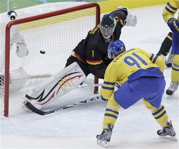 Sweden's LOUI ERIKSSON (91) shoots past German goaltender THOMAS GREISS (1) of the San Jose Sharks for the second Swedish goal. (Matt Slocum/AP)