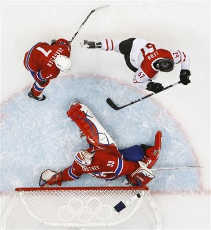 The puck is in the net, the game is over. (AP photo)