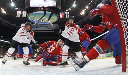 The skate of Norwegian defender JONAS HOLOS halts Paterlini's bid to put Switzerland in front early. (AP photo)